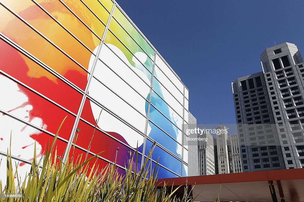 An Apple Inc. logo appears in a graphic covering the exterior of the Yerba Buena Center for the Arts Theater prior to an Apple event in San Francisco, California, U.S., on Wednesday, March 7, 2012. Apple Inc. introduced a new version of the iPad, beefing up its two-year-old mobile computer with a sharper screen to widen its lead over Amazon.com Inc., Microsoft Corp. and Google Inc. in the tablet market. Photographer: Tony Avelar/Bloomberg via Getty Images