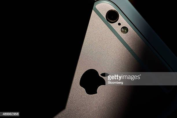 An Apple Inc logo is seen on an iPhone 6s smartphone in an arranged photograph in Hong Kong China on Friday Sept 25 2015 The latest models following...