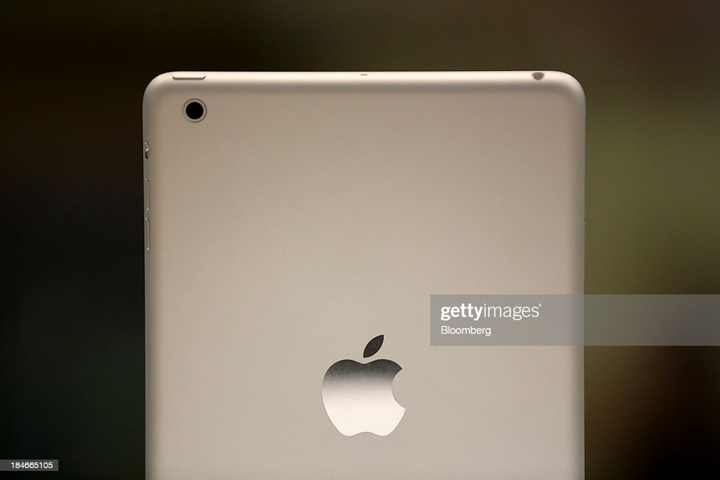 An Apple Inc. logo sits on the back of an iPad tablet on display inside a re:Store premium Apple reseller in Moscow, Russia, on Thursday, Oct. 3, 2013. Burberry Group said Christopher Bailey will become chief executive officer of the largest British luxury-goods producer, as CEO Angela Ahrendts departs the company to work at Apple Inc. Photographer: Andrey Rudakov/Bloomberg via Getty Images
