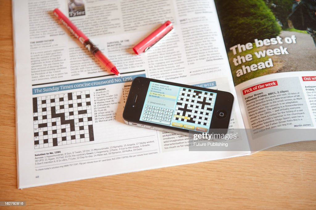 An Apple iPhone 4S smartphone showing a crossword puzzle application, January 17, 2013.