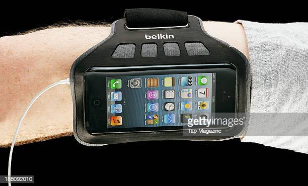 An Apple iPhone 5 with a Belkin EaseFit Armband photographed on a black background taken on March 7 2013