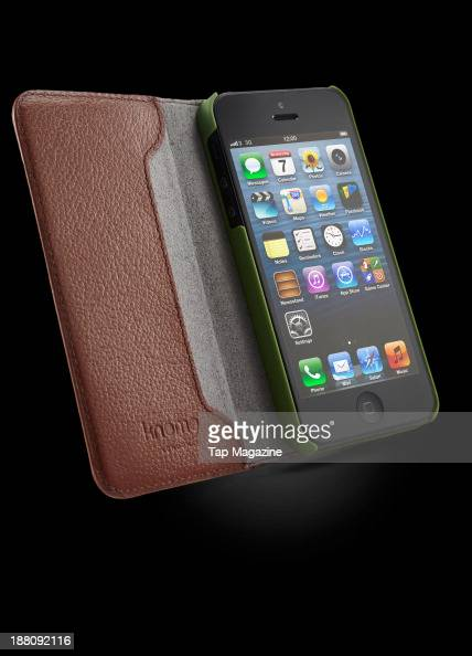 An Apple iPhone 5 with a Knomo iPhone 5 Leather Folio photographed on a black background taken on March 7 2013