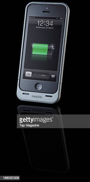 An Apple iPhone 5 with a Mophie Juice Pack Helium photographed on a black background taken on March 7 2013