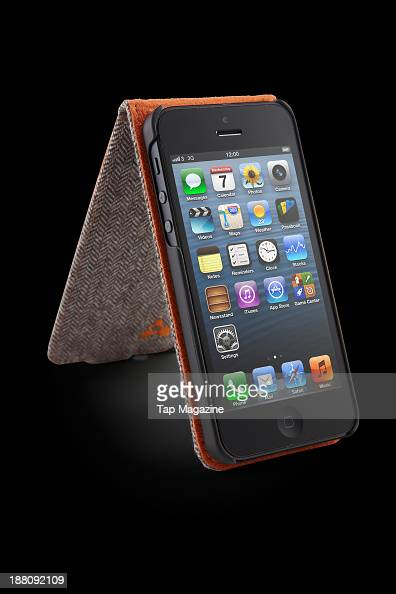 An Apple iPhone 5 with an iChic Gear Oxford Tweed Slim Shell Folio photographed on a black background taken on March 7 2013