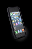 An Apple iPhone 5 with an iLuv Ninja case photographed on a black background taken on March 7 2013