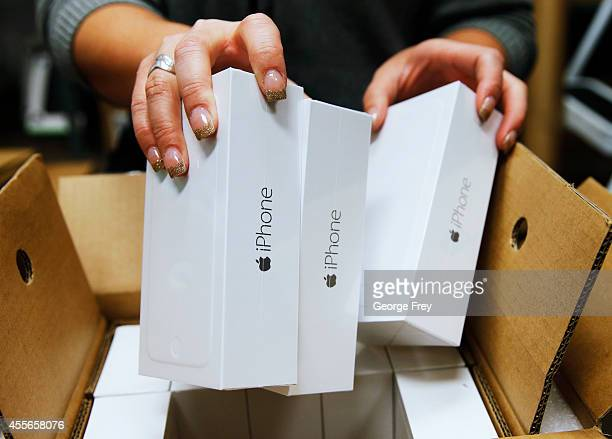An Apple iPhone 6 phones are taken out of a shipping box at a Verizon store on September 18 2014 in Orem Utah Apple's new iPhone 6 and iPhone 6 Plus...