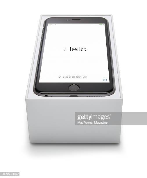 An Apple iPhone 6 photographed in its box with the startup screen visible taken on September 24 2014