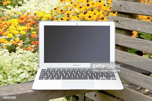 An Apple MacBook Air laptop photographed on a garden bench taken on August 20 2012