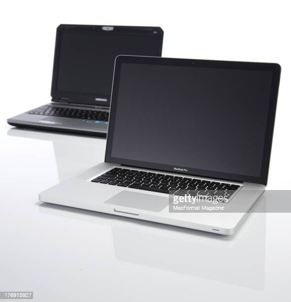 An Apple MacBook Pro and a Medion laptop photographed on a white background for an article on migrating from PC to Mac systems taken on January 25...