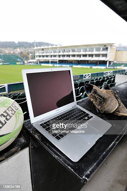 An Apple Macbook Pro with a rugby ball and muddy rugby boots session for MacFormat Magazine taken on February 10 2011