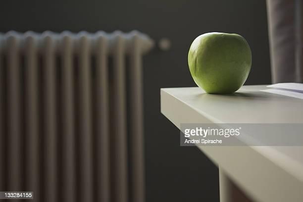 An apple on a desk