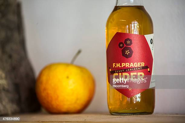 An apple sits beside a bottle of cider at the FH Prager cider store in Prague Czech Republic on Friday June 5 2015 A generation after communism's...