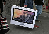 An Apple Store customer carries a brand new iMac computer on January 27 2015 in San Francisco California Apple Inc reported huge first quarter...