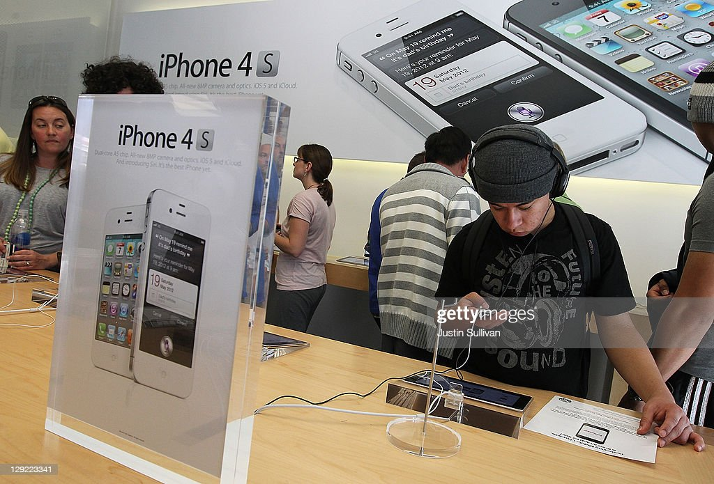 An Apple Store customer looks at the new Apple iPhone 4Gs on October 14, 2011 in San Francisco, United States. The new iPhone 4Gs went on sale today and features a faster dual-core A5 chip, an 8MP camera that shoots 1080p HD video, and a voice assistant program.