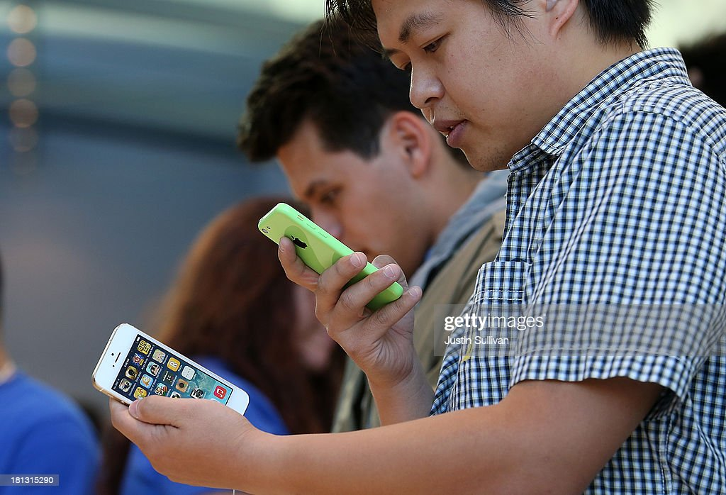 An Apple Store customer looks at the new Apple iPhone 5C and 5S at an Apple Store on September 20, 2013 in Palo Alto, California. Apple launched two new models of iPhone: the iPhone 5S, which is preceded by the iPhone 5, and a cheaper, paired down version, the iPhone 5C. The phones come with a new operating system.