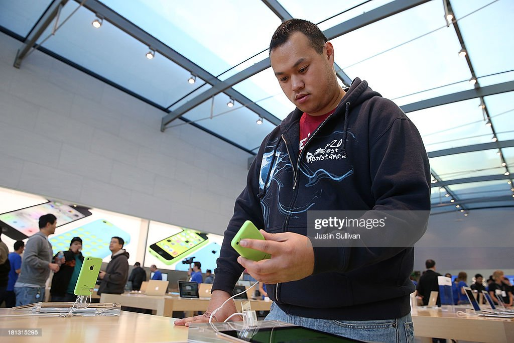 An Apple Store customer looks at the new Apple iPhone 5C at an Apple Store on September 20, 2013 in Palo Alto, California. Apple launched two new models of iPhone: the iPhone 5S, which is preceded by the iPhone 5, and a cheaper, paired down version, the iPhone 5C. The phones come with a new operating system.