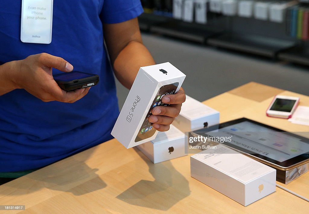 An Apple Store employee rings up a purchase of the new iPhone 5S on September 20, 2013 in Palo Alto, California. Apple launched two new models of iPhone: the iPhone 5S, which is preceded by the iPhone 5, and a cheaper, paired down version, the iPhone 5C. The phones come with a new operating system.