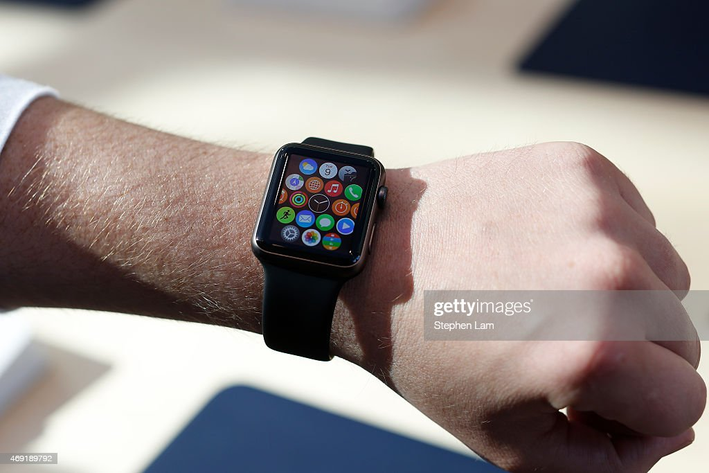 An Apple Store employee wears an Apple Watch at an Apple Store on April 10, 2015 in Palo Alto, California. The pre-orders of the highly-anticipated wearable from the tech giant begin today as the watches arrive at stores for customers to preview.