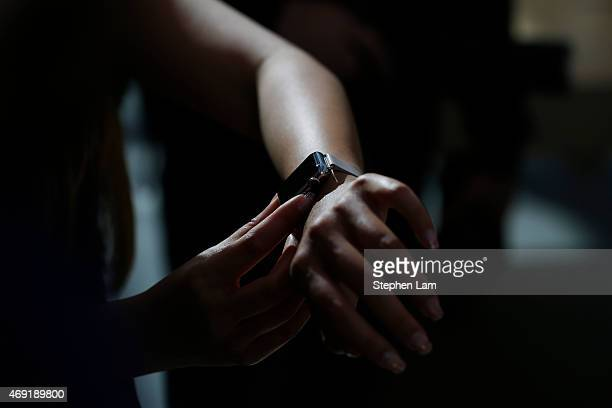 An Apple Store employee wears an Apple Watch at an Apple Store on April 10 2015 in Palo Alto California The preorders of the highlyanticipated...
