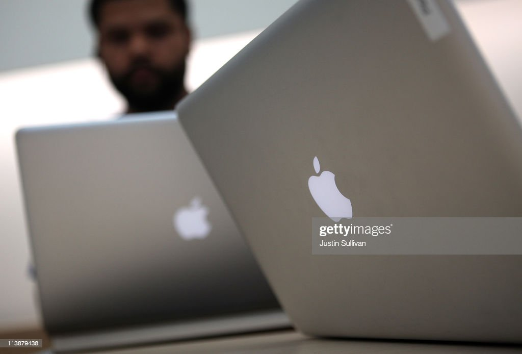 An Apple Store genius bar employee works on a laptop at an Apple Store following an announcement that Apple has become the world's most valuable brand on May 9, 2011 in San Francisco, California. In a report released by London based Millward Brown, Apple Inc. has surpassed Google to claim the top spot in a global ranking of brand value this year with an estimated value of more than $153 billion up 84 percent from last year.