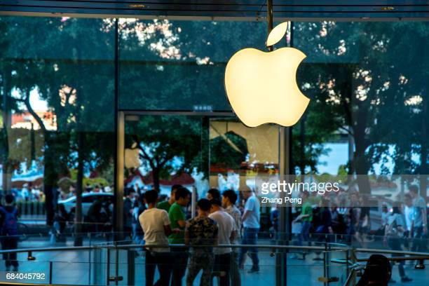 An Apple store in Xidan business street Apple Corp plans to renovate Apple stores and upgrade the hardware this month including a new big screen as...