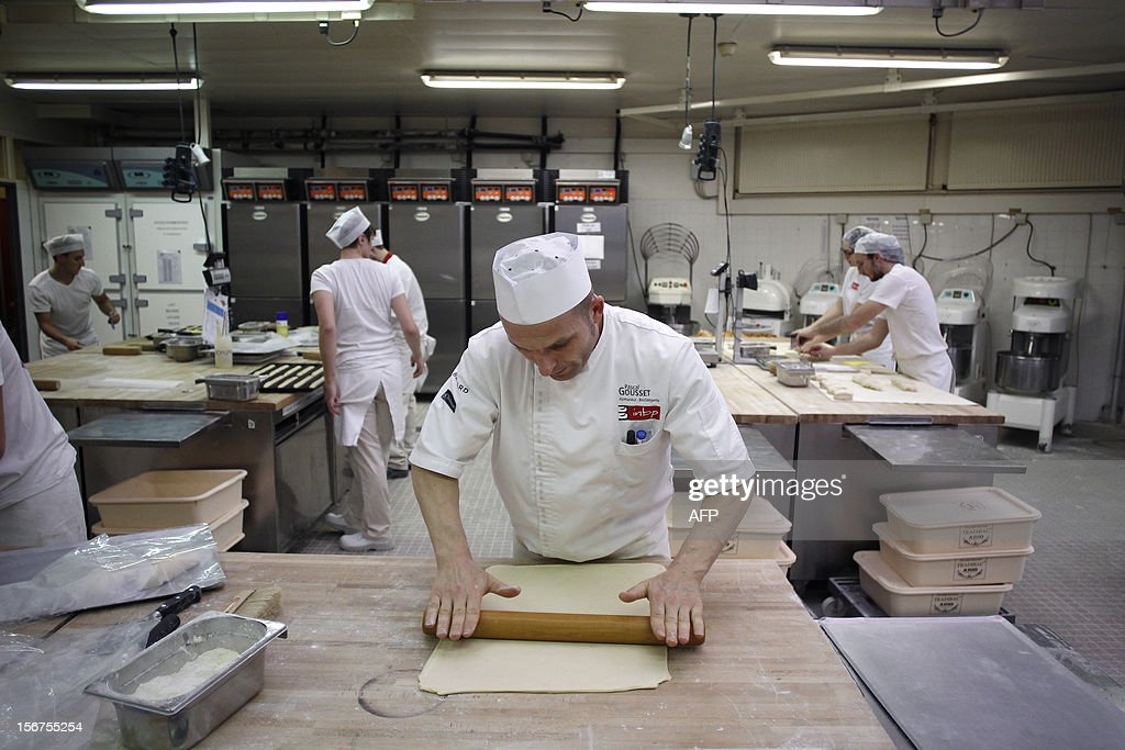 An apprentice manipulates bread dough at the National Bakery and Pastry Institute (INBP - Institut National de Boulangerie et de Patisserie) on November 20, 2012 in the northwestern city of Rouen.