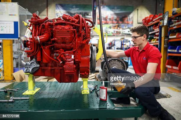 An apprentice works on the engine of an Enviro 200 bus at the Alexander Dennis Ltd factory in Guildford UK on Monday Sept 11 2017 Manufacturing in...
