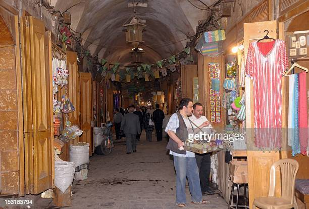 An April 23 file photo shows traders and shops in the medieval souk of the old city of Aleppo in northern Syria The ancient market recognized by...