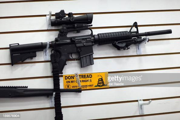 An AR15 is seen for sale on the wall at the National Armory gun store on January 16 2013 in Pompano Beach Florida President Barack Obama today in...