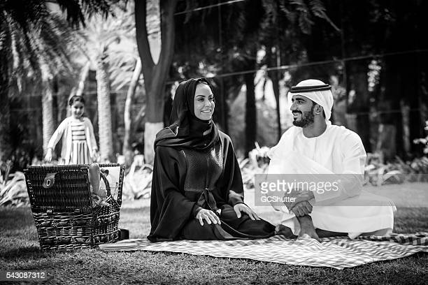 An Arab family with their daughter in a park