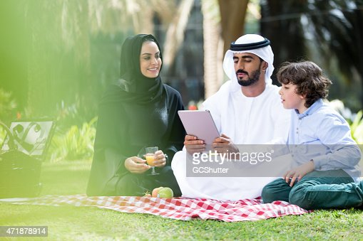 An Arab family with their son in a park