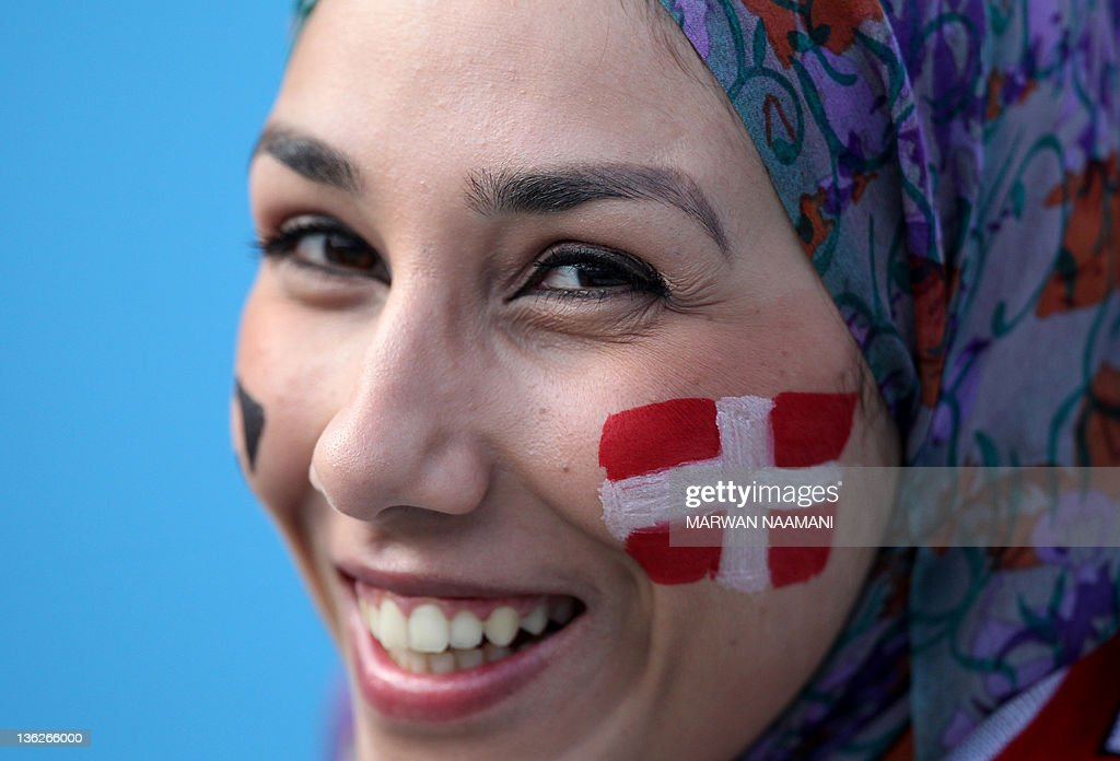 An Arab fan of Roger Federer with the Swiss flag painted on her face attends the Mubadala World Tennis Champisonship semi-final match between Federer and world number one Novak Djokovic of Serbia in Abu Dhabi on December 30, 2011. Djokovic won 6-2, 6-1.