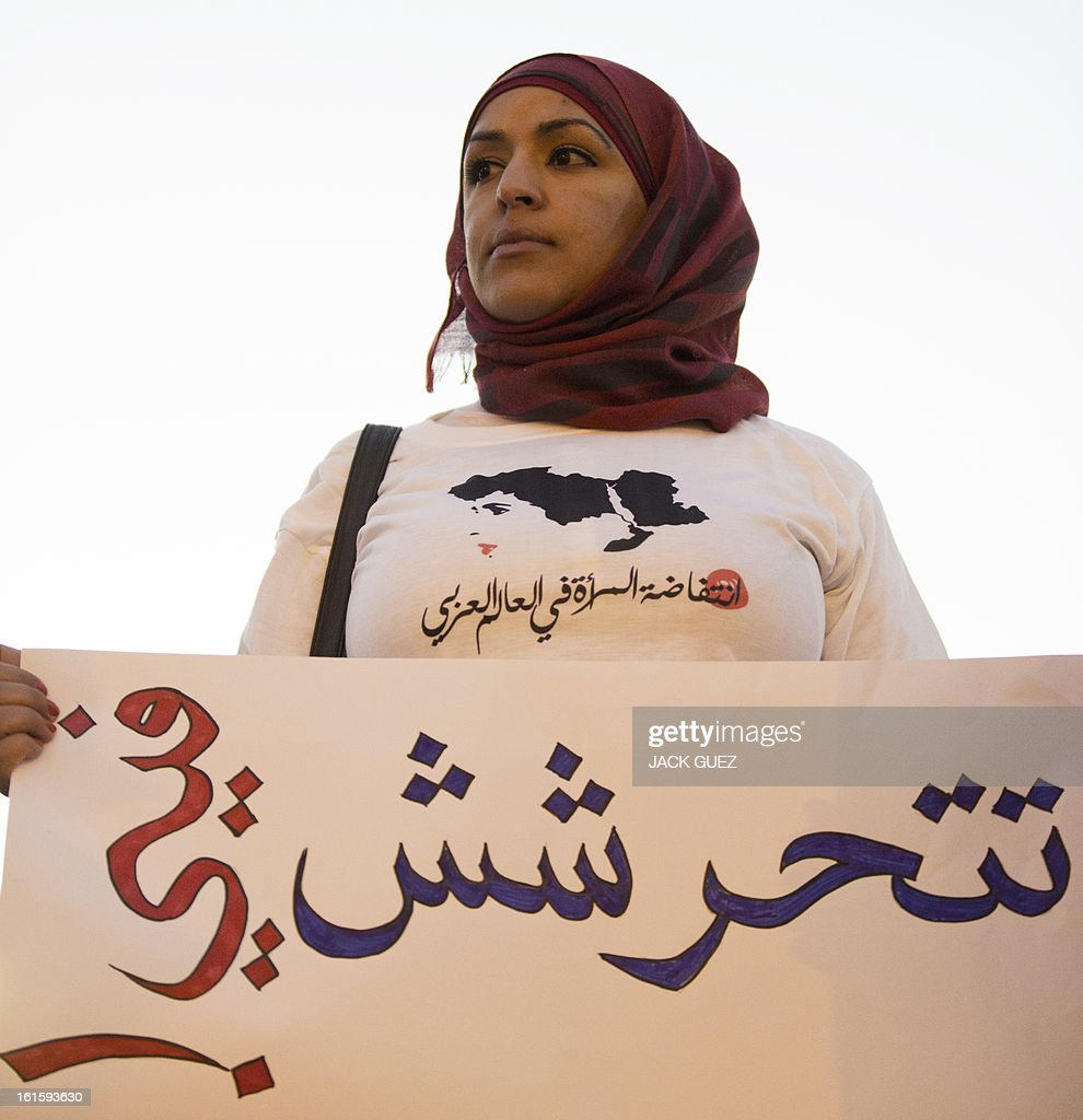 An Arab Israeli carries a placard which reads in Arabic 'don't harass me!' during a protest against sexual violence targeting women in Egypt, in Jaffa north of Tel Aviv, on February 12, 2013. On Cairo's streets, the sexual harassment of women, regardless of whether or not they wear an Islamic headscarf, is common in the form of obscenities, touching or groping.