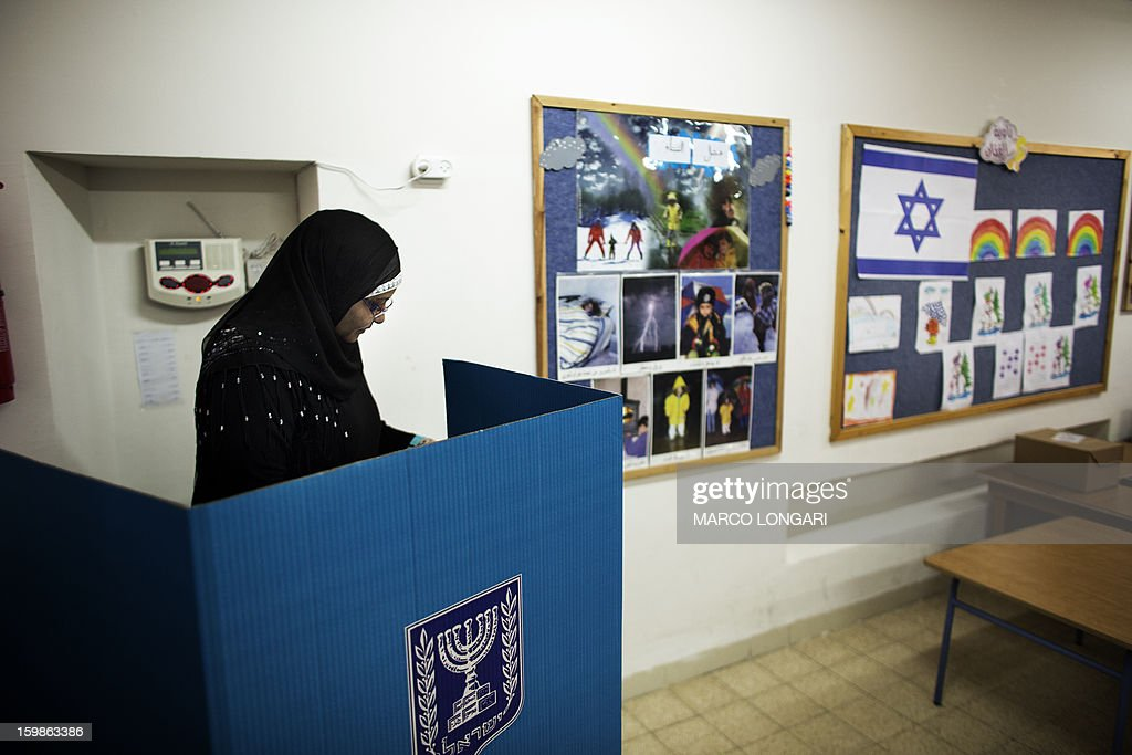 An Arab Israeli woman votes in Acre January 22, 2013 as Israelis started to vote for the 19th Israeli general election. Polls opened on January 22 in Israel's general election, which is expected to return Prime Minister Benjamin Netanyahu to power at the head of a government of hardline right-wing and religious parties. LONGARI