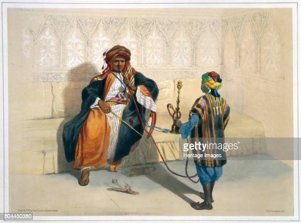 An Arab sheikh smoking 1848 Illustration from The Valley of the Nile by Emile Prisse d'Avennes Artist Saint Germain