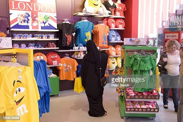 An Arab woman in the four floor MM's ssweet clothes and toy tore located in London's Leicester Square Arabs have been visiting London for centuries...