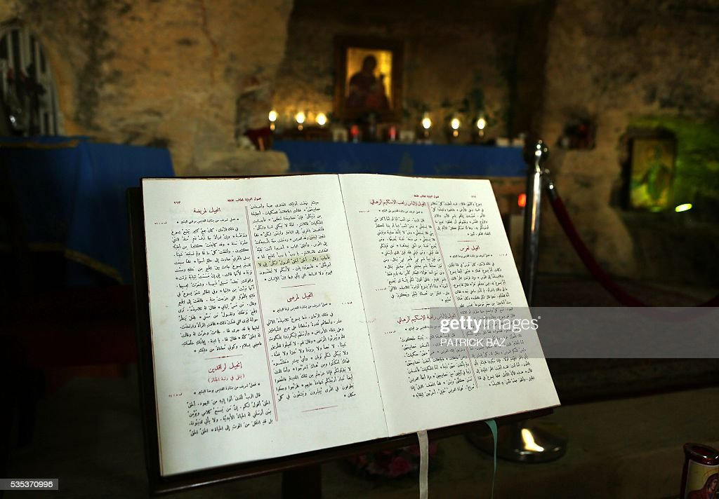 An Arabic version of the Gospel sits in the Grotto of Our Lady of Mantara in the southern Lebanese town of Maghdouche East of Sidon, on May 29, 2016, during the launching of an event by the Ministry of Tourism to put the Grotto of Maghdouche on the international religious tourism map. Magdouche, along with Lourdes in France, Fatima in Portugal and Medugorje in Bosnia & Herzegovina are expected to be put on the international religious tourism map. According to local tradition the Virgin Mary accompanied Jesus during his journey to Tyre and to Sidon and waited for him in the grotto at Magdoucheh. The grotto was discovered 400 years ago. / AFP / Patrick BAZ