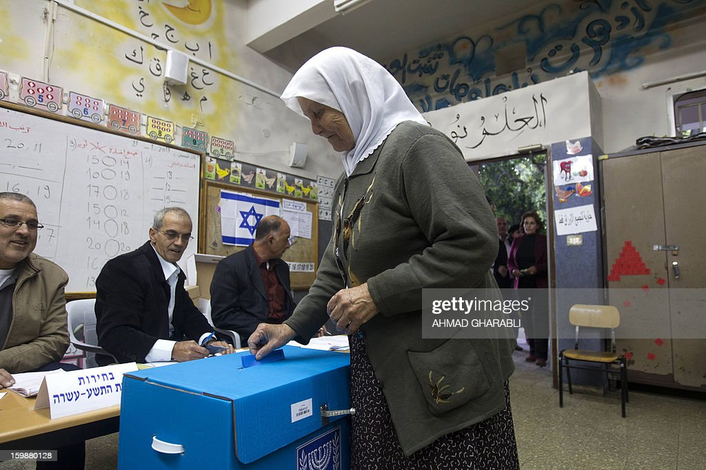 An Arab-Israeli woman casts her ballot at a polling station in the northern Arab-Israeli town of Sakhnin on January 22, 2013. Voters across Israel and in settlements peppering the occupied West Bank cast ballots for the Israeli general election at more than 10,000 polling stations, with turnout standing at 38.3 percent after seven hours of voting.