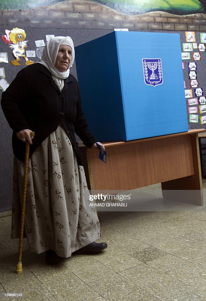 An Arab-Israeli woman leaves a voting booth at a polling station in the northern Arab-Israeli town of Sakhnin on January 22, 2013. Voters across Israel and in settlements peppering the occupied West Bank cast ballots for the Israeli general election at more than 10,000 polling stations, with turnout standing at 38.3 percent after seven hours of voting. AFP PHOTO/AHMAD GHARABLI