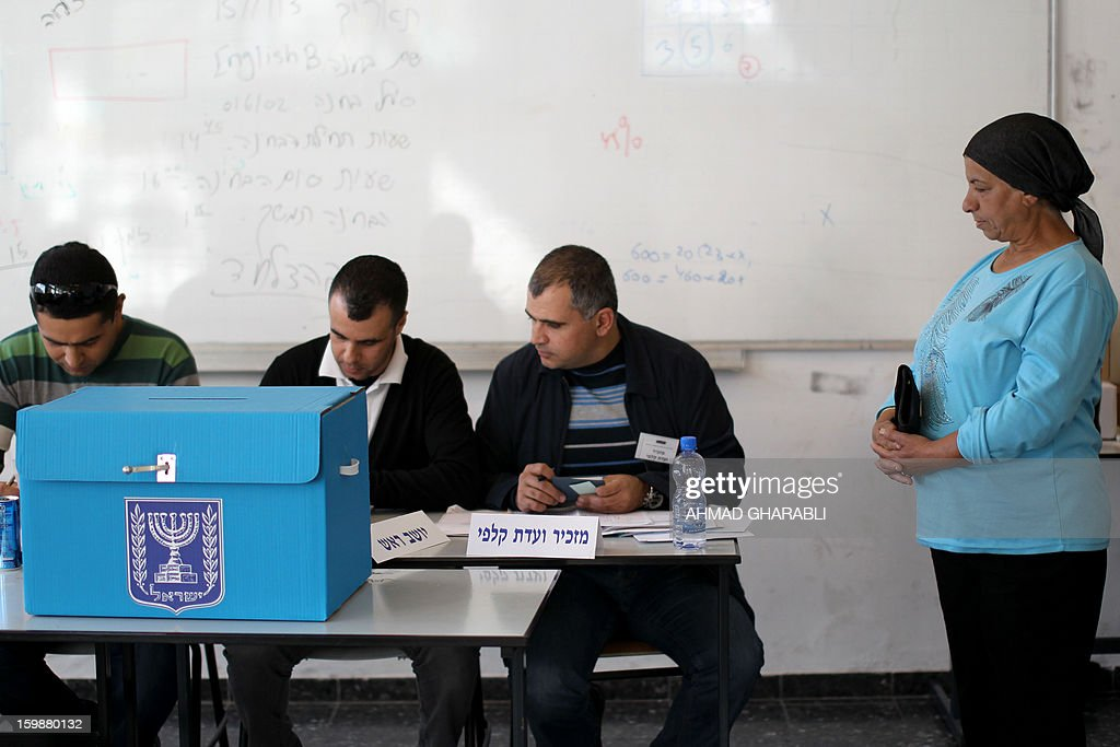 An Arab-Israeli woman waits to vote at a polling station in the northern Arab-Israeli town of Sakhnin on January 22, 2013. Voters across Israel and in settlements peppering the occupied West Bank cast ballots for the Israeli general election at more than 10,000 polling stations, with turnout standing at 38.3 percent after seven hours of voting.