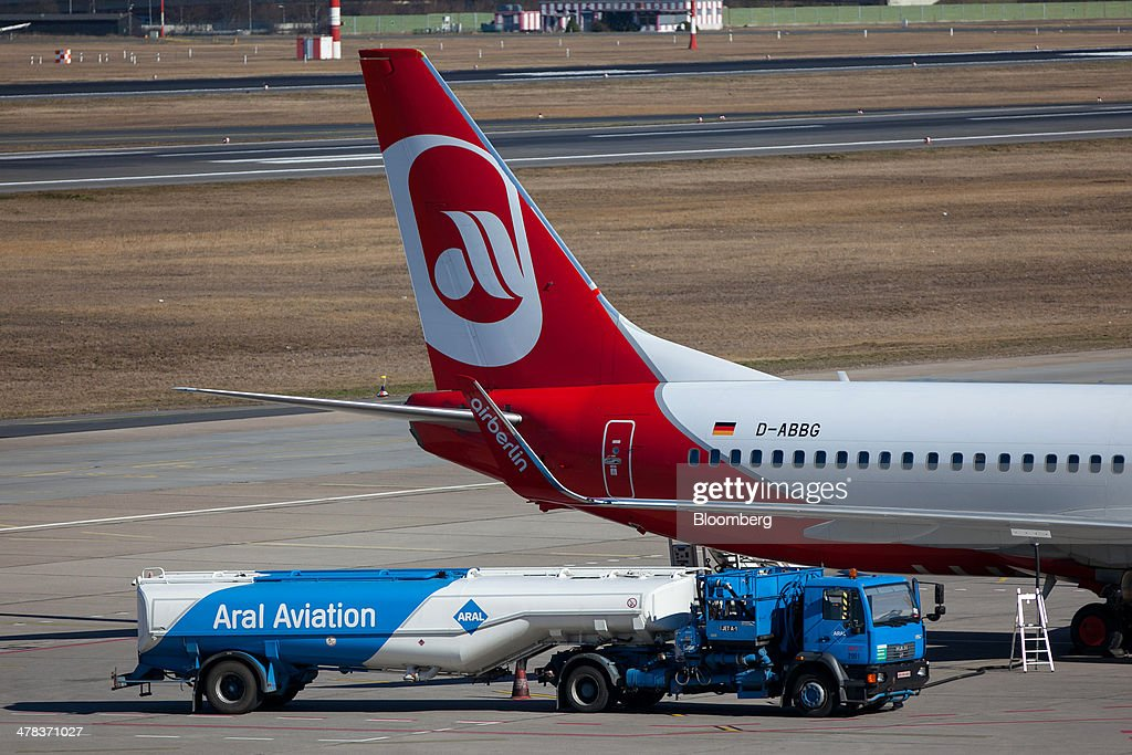 An Aral AG fuel truck sits on the tarmac beside an Air Berlin aircraft at Tegel airport, operated by Flughafen Berlin Brandenburg GmbH, in Berlin, Germany, on Wednesday, March 12, 2014. Berlin's Tegel airport has subsisted by chance alone, defying the odds as passenger growth outpaces every other major hub in Western Europe. Photographer: Krisztian Bocsi/Bloomberg via Getty Images