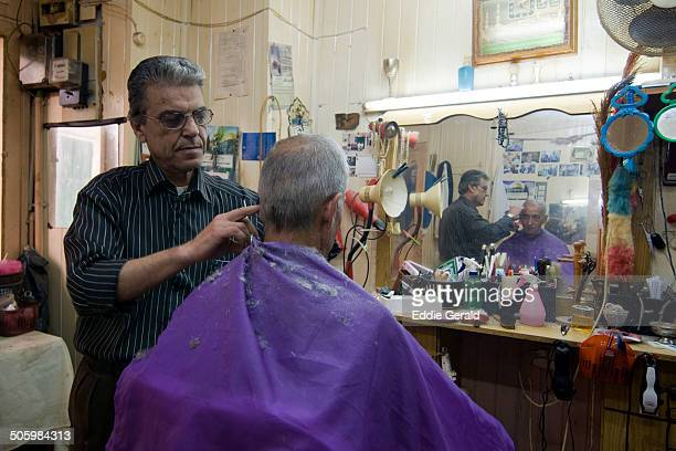 An Aran barbershop in the town of Nazareth Israel May 2005