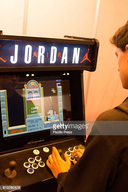 An Arcade Machine of Tetris Thousands of people come to the event dedicated to the Japan Culture Cosplay Video games Retro Video games and Cultural...