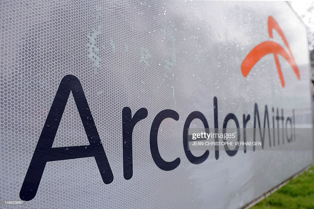 An ArcellorMittal logo is pictured at the entrance of ArcelorMittal steel headquarters on April 11 2012 in Florange northeastern France AFP PHOTO /...