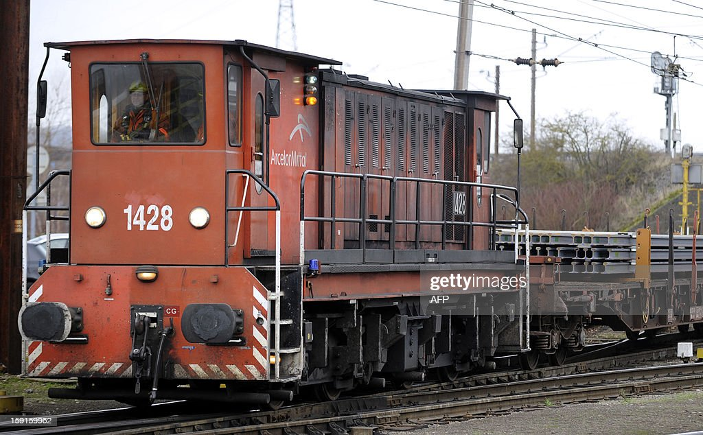 An ArcelorMittal train is seen on the Ebange railway station, eastern France, as it transports rails from Nilvange Indian Tata steel factory, on January 9, 2013. Ebange is the only train route to Florange ArcelorMittal plant.