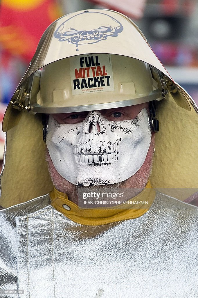 An ArcelorMittal worker wears a skeleton mask and a steelmaker helmet with a sticker reading 'Full Mittal Racket' during a demonstration called by French CGT trade union on February 13, 2013 in Metz, eastern France, to claim for the safeguard of the local industry in the French eastern region of Lorraine.
