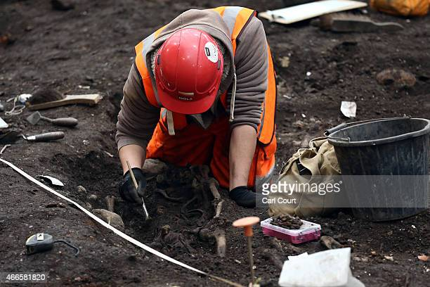 An archaeologist from the Museum of London Archaeology works on the Bedlam burial ground where it is believed over 20000 Londoners were buried...