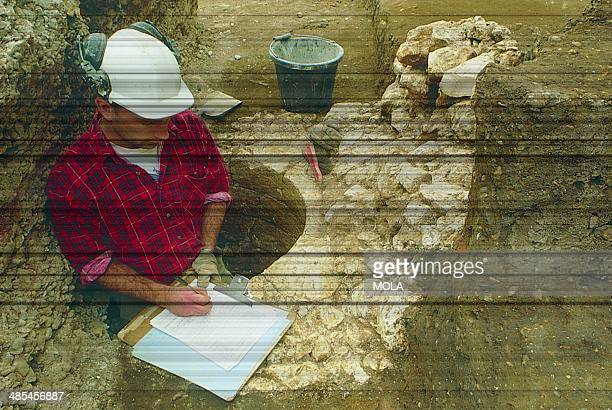 An archaeologist standing in a chalklined well associated with Blackwell Hall from the 19929 excavations at the Guildhall City of London