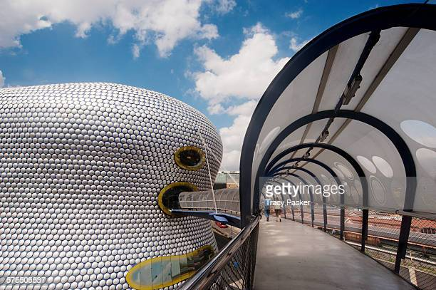 An arched entrance footbridge provides an elevated view of the facade of the iconic Selfridge's Building designed by Future Systems and built in 2003...