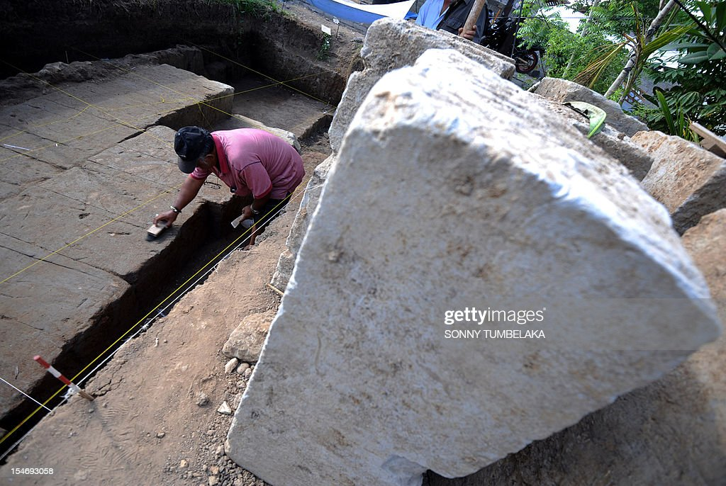 An archeologist excavates the remains of an ancient Hindu temple in Denspasar on Indonesia's Bali island on October 25, 2012. Construction workers in Bali have discovered what is thought to be the biggest ancient Hindu temple ever found on the Indonesian island, archaeologists said.
